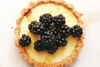 the lemon filling in these tartlets is delightfully creamy and light ...