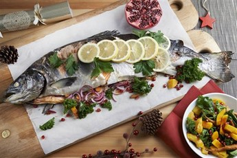 Whole baked salmon with kale, squash and pomegranate salad recipe