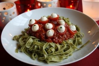 Green slime eyeball pasta with fiery hell sauce recipe